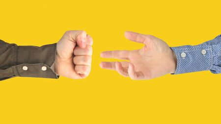 Various gestures of male hands between each other on a yellow background. Gestures relations in society. Discussion and understanding your opponent with your hands