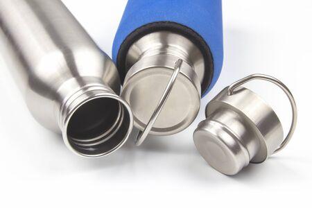 metal steel water flasks on white background. metal drinking utensils