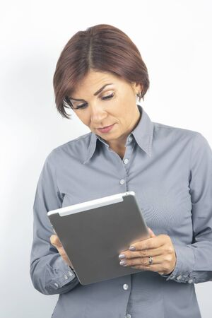 Business woman in a shirt and a tablet in her hands. determination and career growth
