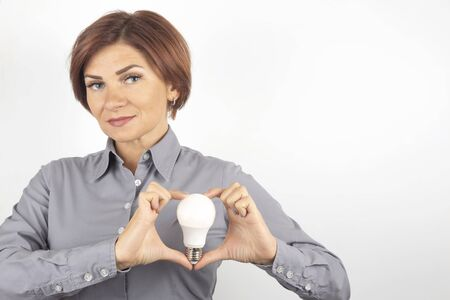 beautiful woman with LED lamp in hands on a white background Stock Photo