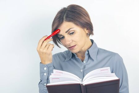 Business lady with a red pen and documents in her hands on a white background.