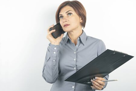 Business lady with phone and documents in hands on white background.