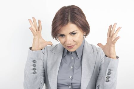 beautiful business woman expresses her emotions and thoughts on was background