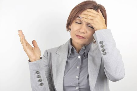 The business woman is tired and worried in emotions. Stress and headache. Working shocks.
