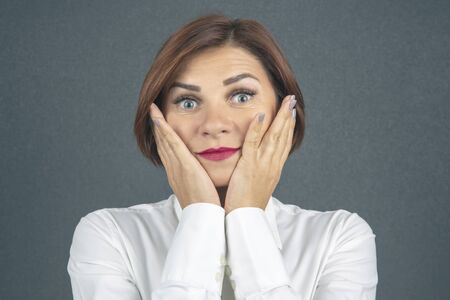 beautiful business woman expresses her emotions and thoughts Stock Photo