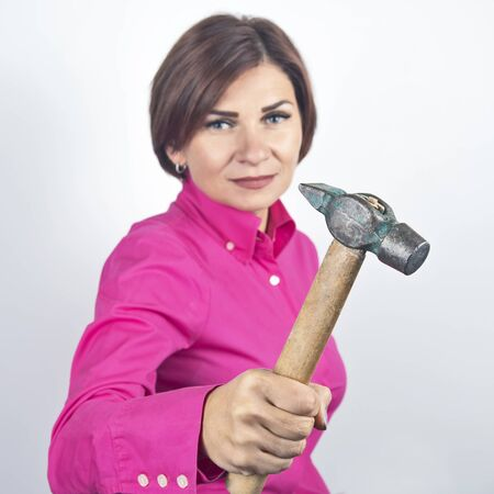 beautiful woman with a hammer in her hand Stock Photo