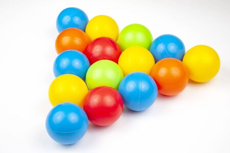 Colored plastic balls on white background. leisure and game items. round objects Archivio Fotografico
