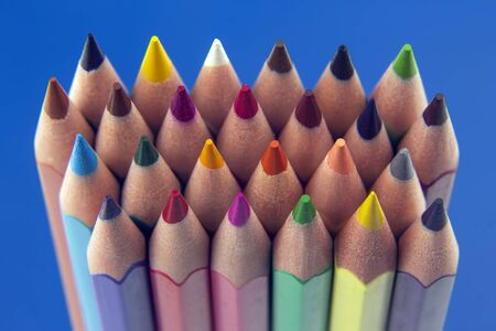 set of color pencils on a blue background. drawing tools. a palette in creativity Archivio Fotografico