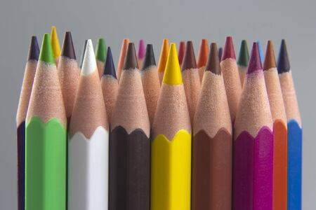 set of color pencils on a gray background. drawing tools. color palette in creativity