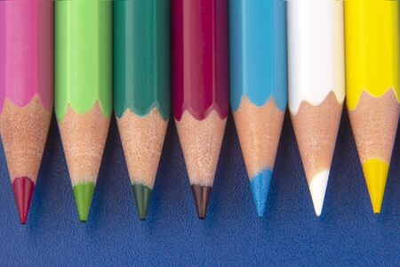 set of color pencils on a bright blue background. drawing tools. a palette in creativity Archivio Fotografico