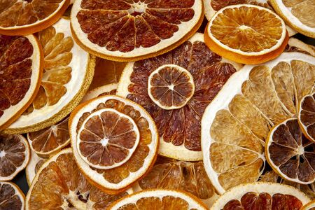 mix of different pieces of dried citrus fruit. vitamin fruits. healthy food