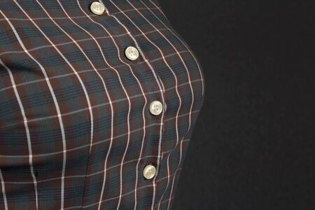 Female cotton shirt with buttons close-up in the chest Archivio Fotografico