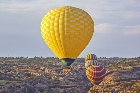 balloon is flying in mountainous area in Cappadocia. Turkey Archivio Fotografico