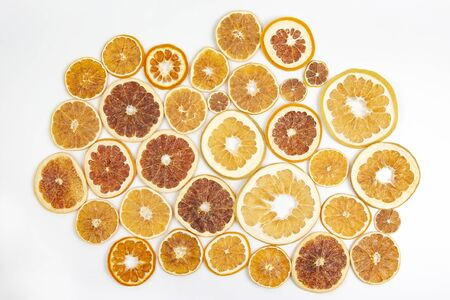 Dried slices of various citrus fruits on white background
