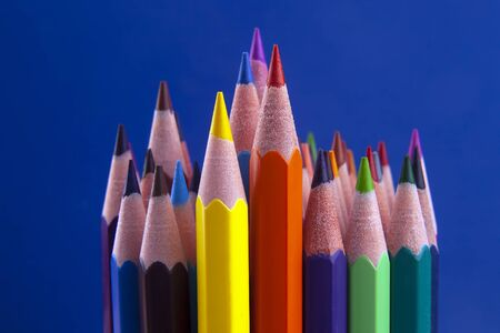 set of color pencils on a bright blue background. drawing tools. a palette in creativity