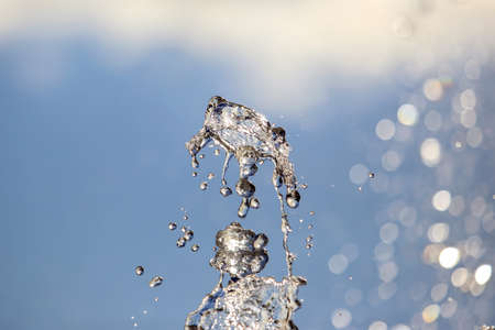 abstract figure of a water fountain on blurred background Archivio Fotografico