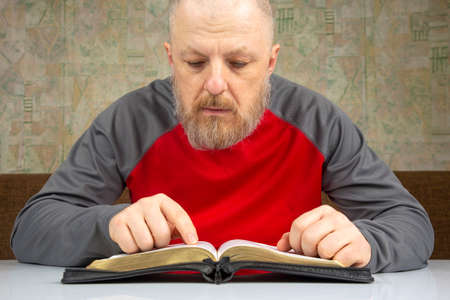 bearded man studies the Bible. religion and Christianity.