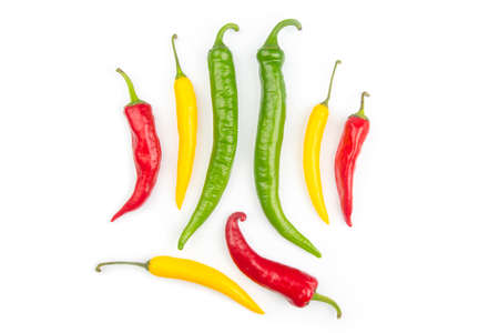 Colored hot chili on a white background. Pepper. Vegetable vitamin food.