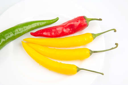 Colored hot chili on a plate. Pepper. Vegetable vitamin food Reklamní fotografie