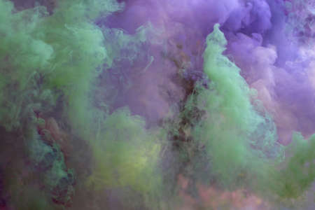 Colored creeping smoke. Blurred background.