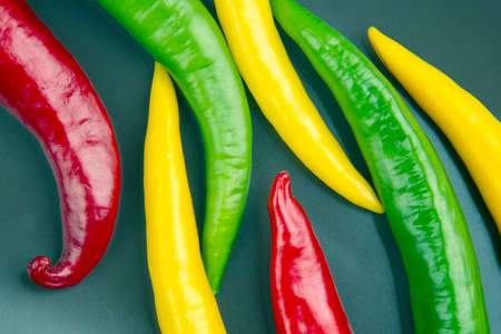 Colored hot chili on a gray background. Pepper. Vegetable vitamin food Reklamní fotografie
