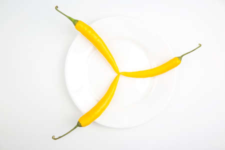 yellow hot chili on a white background. Pepper. Vegetable vitamin food Reklamní fotografie