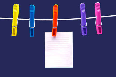paper notepad for reminder hanging on colored clothespins