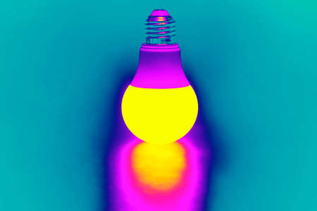 LED lamp glowing in the ultra violet spectrum. Business and savings. Modern technology and electricity