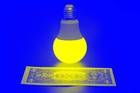 Glowing LED lamp and one dollar bill on a blue background. Business and savings. Modern technology and electricity Zdjęcie Seryjne