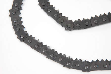 hand folding chain saw for wood on a white background. tool for tourism and camping.