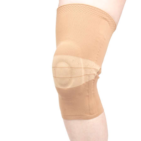 bandage for fixing the injured knee of the human leg on a white background. medicine and sports. limb injury treatment