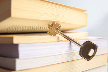 Key and open textbook of life. The book is the key and opening to knowledge and wisdom.