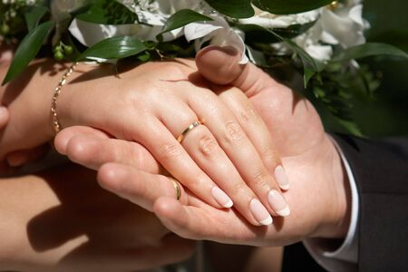 Couple showing there hands with wedding rings Stock Photo - 4310956