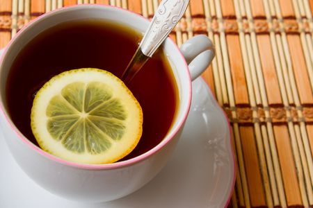 Cup of black tea with lemon - closeup view Stock Photo