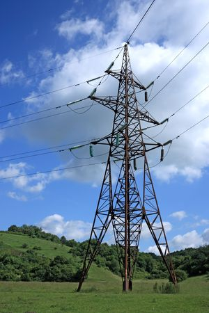 Big electrical tower on meadow Stock Photo