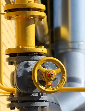 The gas gate, yellow valve and yellow pipes.