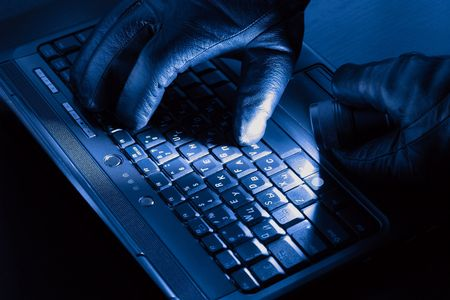 Hands of hacker on a laptop