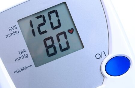 Automatic digital blood pressure monitor - closeup view. Stock Photo