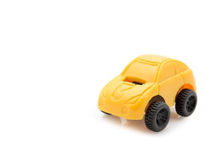 Single yellow toy car over white background Stock Photo