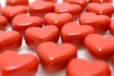 Rows of red wooden hearts - closeup view