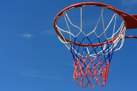 Basketball hoop over blue sky Stock Photo