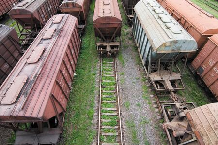 Freight Station with many old wagons of USSR on rails