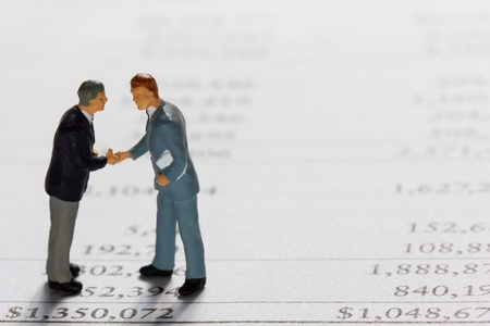 of miniature: Miniature businessmans on report  Business concept