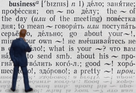 Figure of businessman who thinks about meaning of word  business ; written in russian language Stock Photo