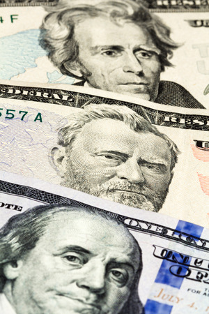 Close-up on the numbers of dollar bills - twenty, fifty and one hundred