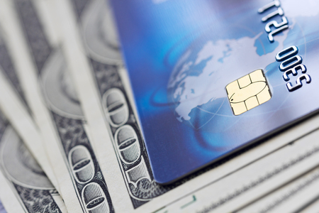 Credit card and banknotes. Shallow depth of field. Stock Photo