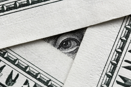 Business concept -  usd banknotes and Franklin looking from one of them