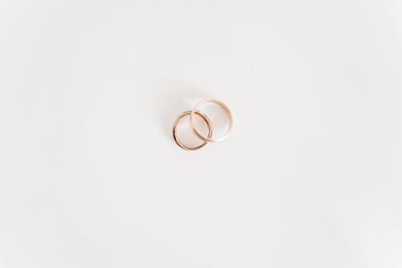 Beautiful silver background with wedding rings Stock Photo
