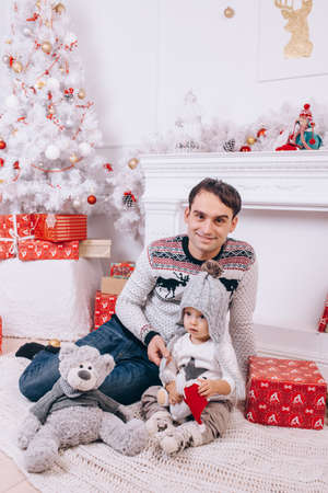 a young father and his son celebrate christmas in a room Stok Fotoğraf