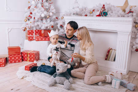A happy family in the living room at Christmas